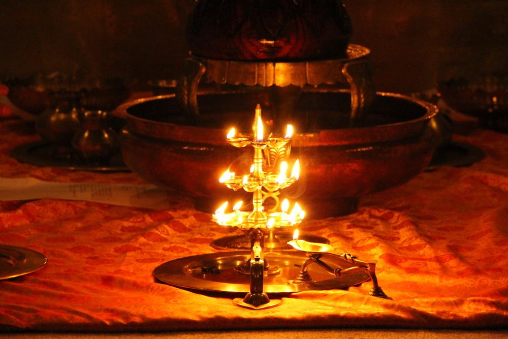 Offering oil lamp (deepam) druing puja
