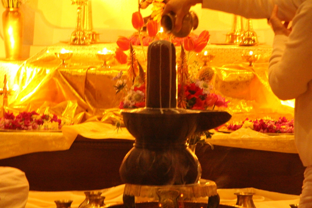 Society of Abidance in Truth | Puja to Siva-Lingam